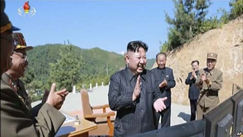 This image made from video of a news bulletin aired by North Korea's KRT on Tuesday, July 4, 2017, shows what was said to be North Korea leader Kim Jung Un, center, applauding after the launch of a Hwasong-14 intercontinental ballistic missile, ICBM, in North Korea.