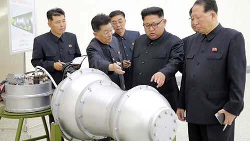 This undated picture released by North Korea's official Korean Central News Agency (KCNA) on September 3, 2017 shows North Korean leader Kim Jong-Un (C) looking at a metal casing with two bulges at an undisclosed location. AFP photo.
