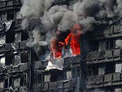 London fire PA. At least 12 are dead as blaze rips through west London tower block. Photo - Business Insider
