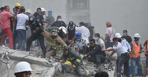 Mexico in frantic search for survivors after huge quake. Photo - news wires