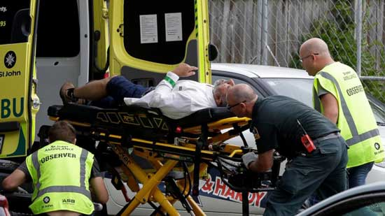 (AP)  Ambulance staff take a man from outside a mosque in central Christchurch, New Zealand, Friday, March 15, 2019. A witness says many people have been killed in a mass shooting at a mosque in the New Zealand city of Christchurch.