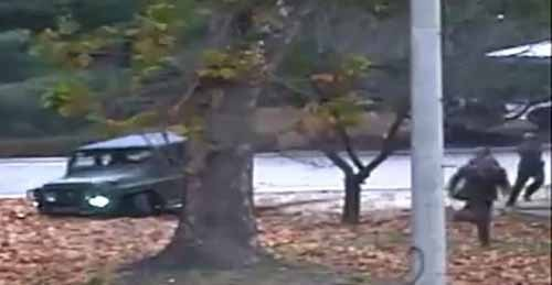 © UN Command handout, AFP | This screengrab from footage released by the United Nations Command on November 22, 2017 shows a North Korea defector (2nd R) being pursued by North Korean soldiers.