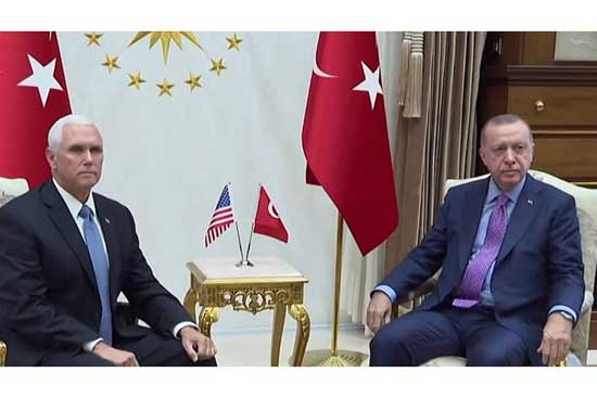 U.S. Vice President Mike Pence (L) with Turkey's President Tayyip Erdogan. Image credit - Newswires