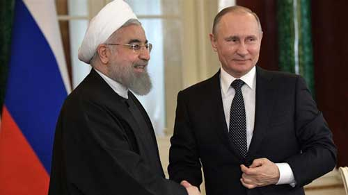 Putin and Rouhani have warned that there would be consequences for the attacks on Syria [File: Alexey Nikolsky/EPA]