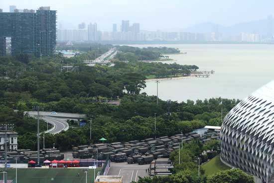 FILE PHOTO: Chinese paramilitary vehicles are parked at the Shenzhen Bay Sports Center in Shenzhen near the border with Hong Kong, China August 18, 2019. REUTERS/Martin Pollard