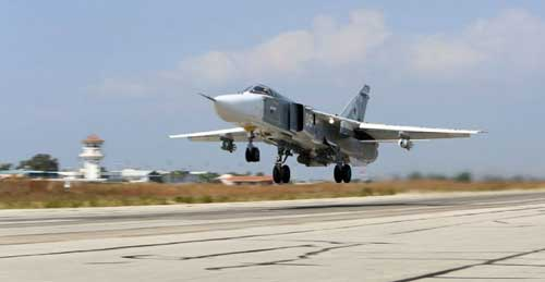 A Russian Sukhoi jet flies out of Hmeimim air base in Syria in October 2015. AP photo