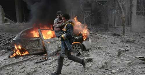 © Abdulmonam Eassa, AFP | A Syrian paramedic carries an injured child following reported bombardment by Syrian and Russian forces in the rebel-held town of Hamouria in eastern Ghouta on January 6, 2018.