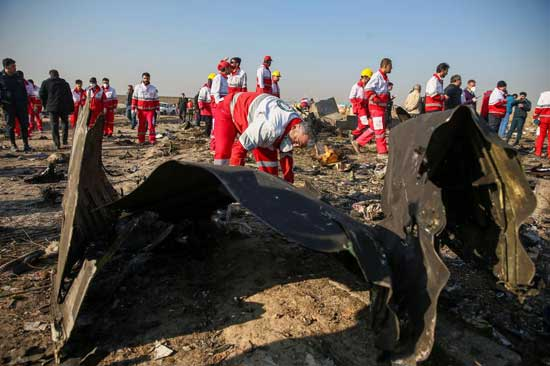 Red Crescent workers check the debris from the Ukraine International Airlines plane, that crashed after take-off from Iran's Imam Khomeini airport, on the outskirts of Tehran, Iran January 8, 2020. File photo