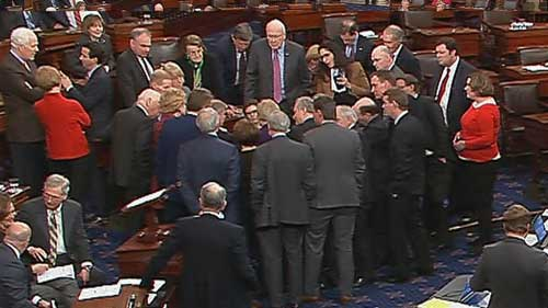 Senate huddle moments before the government shutdown on Jan. 20, 2018. NBC photo