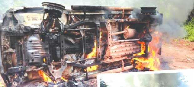 File image - A vehicle set ablaze by angry workers at the Ghana Bauxite Company.