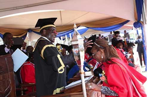 President Mugabe capping his wife, DR Grace Mugabe, at the 2014 Congregation