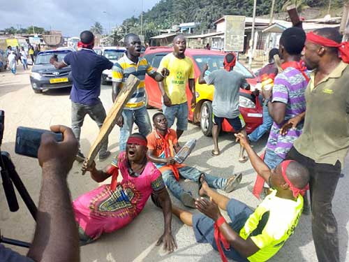 A group demonstrating over bad roads at Tarkwa in the central region.