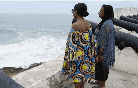 Two African American guests visiting the Cape Coast Castle as part of the 'year of return' celebrations stare into the vastness of the Atlantic Ocean where many were carted off into slavery in America and the new world.