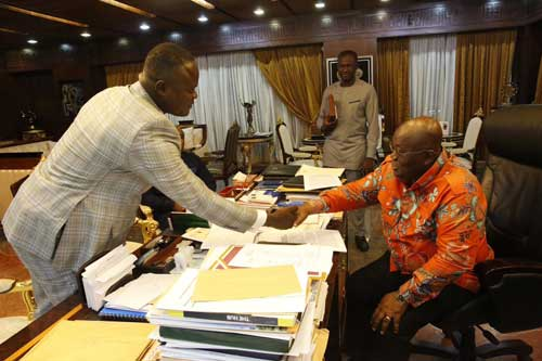 Cwesi Oteng presents album to Akufo-Addo