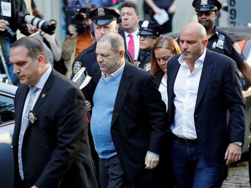 Film producer Harvey Weinstein (M) arrives at the 1st Precinct in Manhattan in New York, May 25, 2018. Image credit - abcnewsgo