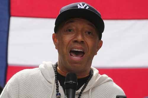 "roducer Russell Simmons take part in an ""I am Muslim Too"" rally in Times Square Manhattan, New York, U.S. February 19, 2017. REUTERS/Carlo Allegri/File Photo"