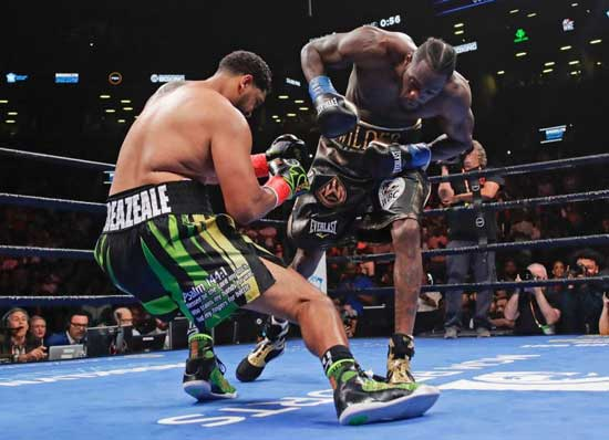 Deontay Wilder knocks down Dominic Breazeale during the first round of the WBC heavyweight title fight Saturday, May 18, 2019, in New York. (AP Photo/Frank Franklin II)