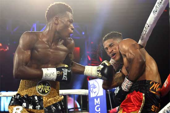 Richard Commey  (L) knocks out Jackson Marinez. Photo by Mikey Williams/Top Rank Inc via Getty Images