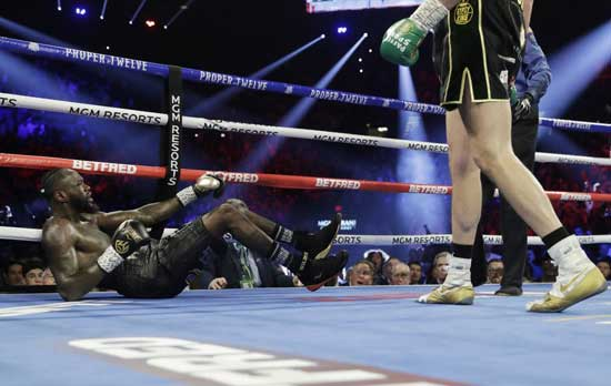 Tyson Fury, of England, knocks down Deontay Wilder during a WBC heavyweight championship boxing match Saturday, Feb. 22, 2020, in Las Vegas. (AP Photo/Isaac Brekken)