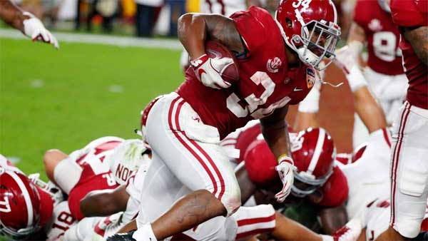 No. 1 Alabama beats No. 4 Oklahoma 4Alabama running back Damien Harris (34) scores a touchdown, during the first half of the Orange Bowl NCAA college football game against Oklahoma, Saturday, Dec. 29, 2018, in Miami Gardens, Fla. (AP Photo/Wilfredo Lee)5-34 to reach title game