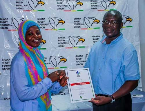 File image - Rafatu Inusah (Ghana Women's Rugby), receiving a certificate from Mr. Steve Noi (GRFU Board Member and a Tournament Commissioner).