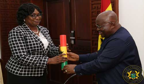 Newly appointed Deputy Special Prosecutor Jane Cynthia Naa Korshie Lamptey receiving a pennant from Pres Akufo-Addo after being sworn into office.