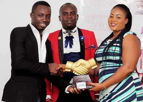 Dr. Raphael Nyarkotey Obu (M) with Yvonne Dzifa Bedi CEO of Men's Health Foundation receiving the award.