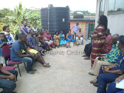 The poilce CID boss Madam Tiwaa Addo-Danquah (standing), speaking with the family of one of the kidnapped girls
