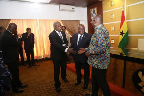 Newly appointed Special Prosecutor, Mr. Martin Amidu (L) shakes hands with VP Dr. Bawumia with President Akufo-Addo (M) looking on.