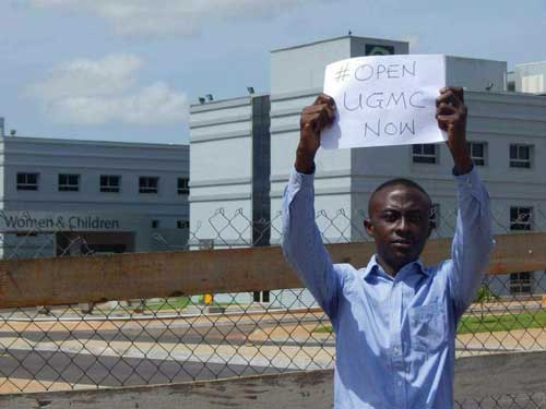 File image - Reginald Sekyi-Brown holding a placard in front of the UGMC