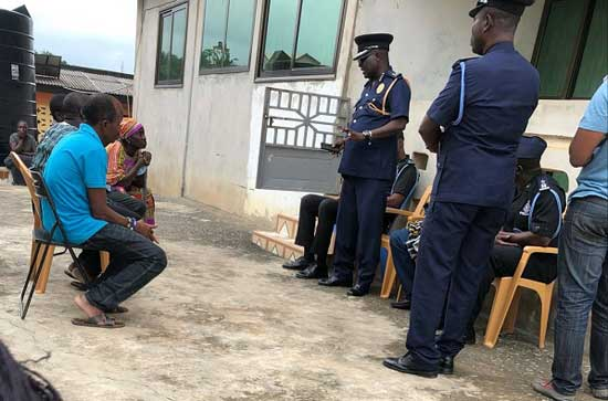 DCOP Redeemer Vincent Dedjoe (arrowed) speaking to family members of the missing girls in Takoradi. Image credit - graphiconlinecomgh