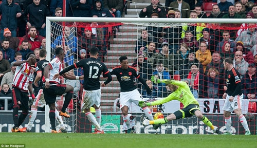 Anthony Martial attempts to keep out Lamine Kone's header on the line as David de Gea falls on the ball and knocks it in
