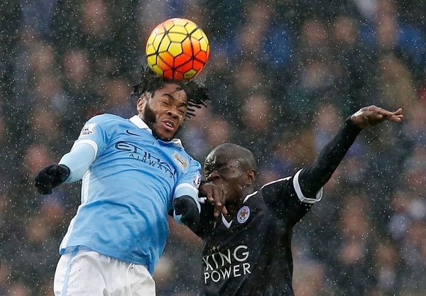 City's Raheem Sterling fights for the ball against Leicester's Ngolo Kante