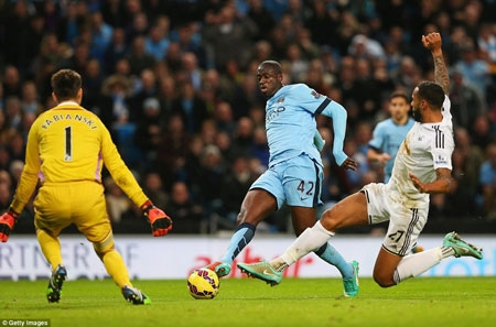 Toure (centre) scored City's winner midway through the second half after bursting into the penalty box before firing home a late shot