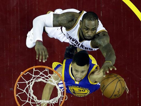 Cleveland Cavaliers forward LeBron James (23) blocks a shot by Golden State Warriors guard Stephen Curry (30) in Game 6 of the NBA Finals at Quicken Loans Arena.