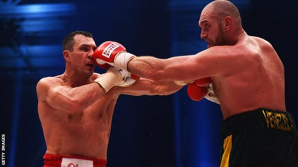Tyson Fury (R) became the first boxer to beat Wladimir Klitschko in 11 years as he won the WBA, IBF and WBO heavyweight titles in a unanimous decision.