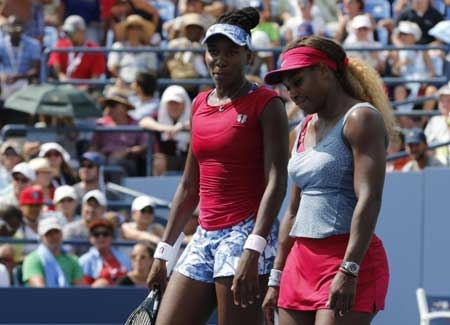 Venus (l.) and Serena Williams are called 'the Williams brothers' by the head of the Russian Tennis Federation who also referred to the American stars as 'scary.'