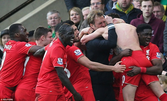 Liverpool Coach, Jurgen Klopp embraces Lallana after the England international's first league goal of the season brought the winner.
