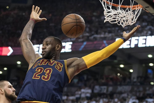 Cleveland Cavaliers forward LeBron James scores a basket during the third quarter of Game 6 of the Eastern Conference final of the NBA playoffs against the Toronto Raptors