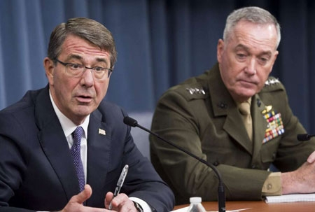 Defense Secretary Ash Carter, accompanied by Joint Chiefs Chairman Gen. Joseph Dunford, announces that U.S. forces killed a senior Islamic State leader, among several key members of the militant group eliminated this week, during a news conference at the Pentagon, March 25, 2016.