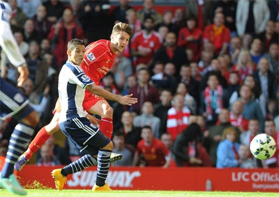 Lallana fires a shot past Ben Foster (not pictured) in the West Brom goal