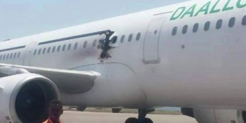 A bomb caused the explosion that ripped a hole in the fuselage of a passenger plane shortly after it took off from Somalia's main airport on Tuesday, killing one person, the government said.
