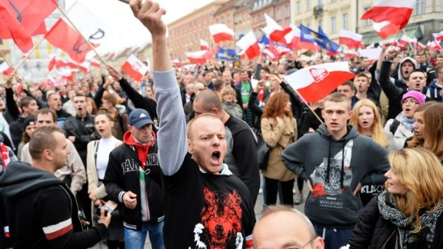 Right-wing demonstrators shout slogans as they take part in a protest against migrants in Warsaw on September 12, 2015.