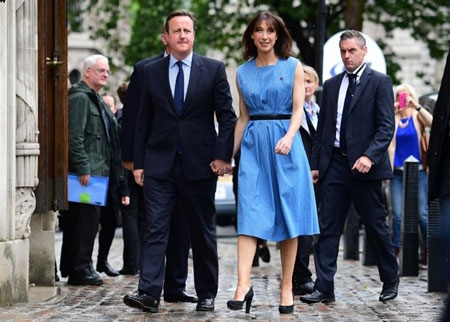 British Prime Minister David Cameron and his wife Samantha arrived to cast their votes in the EU referendum, at a polling station in London.
