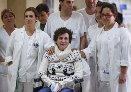Teresa Romero arrives with medical workers to give a press statement before she leaves the Carlos III hospital in Madrid, Spain after recovering from Ebola. The nursing aide had treated two missionaries who died of Ebola in August and September after they were flown back from West Africa