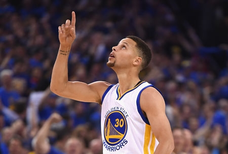 Stephen Curry who poured in 46 points to lead the Warriors to their record 73rd win reacts after making a basket.