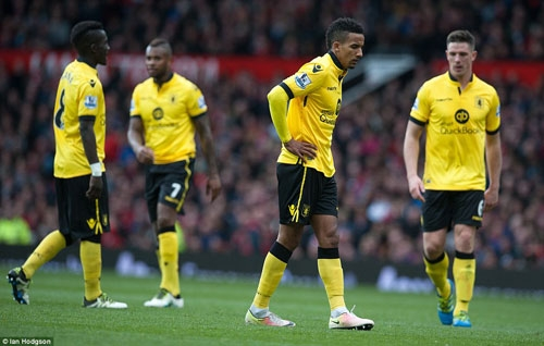 Dejected Aston Villa players after losing to Manchester Utd.