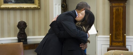 President Barack Obama gives a hug to Dallas nurse Nina Pham in the Oval Office of the White House Friday.