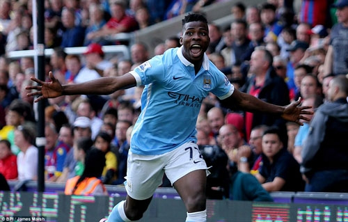 A jubilant Iheanacho wheels away in celebration after scoring moments after entering the game from the substitute's bench