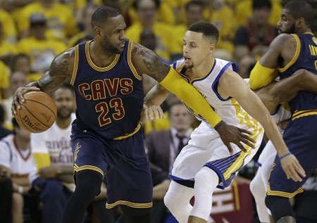 Stephen Curry, right, guarding Cleveland's LeBron James, had just 11 points in Game